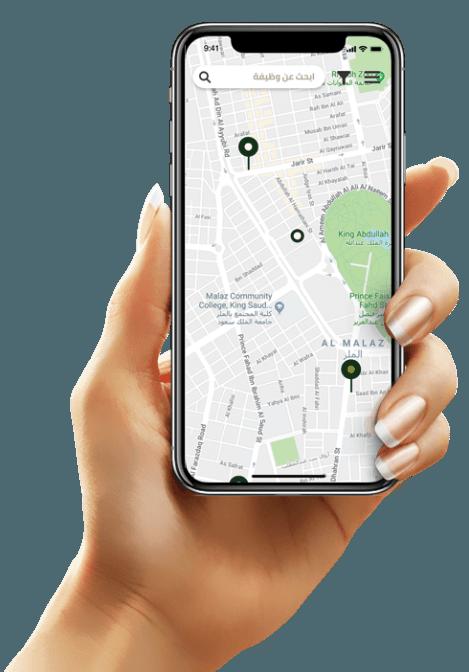 Hand holding phone with Fursah app
